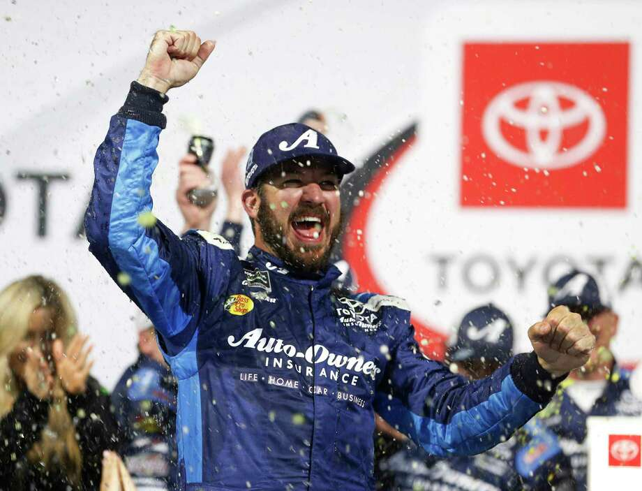 Martin Truex Jr. celebrates in Victory Lane after winning the NASCAR Cup Series auto race at Richmond Raceway in Richmond, Va., Saturday, April 13, 2019. (AP Photo/Steve Helber) Photo: Steve Helber / Copyright 2019 The Associated Press. All rights reserved.