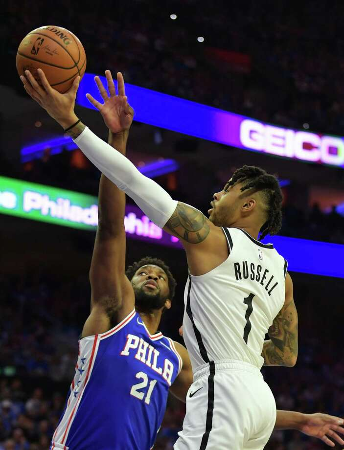 PHILADELPHIA, PA - APRIL 13: D'Angelo Russell #1 of the Brooklyn Nets lays up a shot past Joel Embiid #21 of the Philadelphia 76ers in the first half during Game One of the first round of the 2019 NBA Playoff at Wells Fargo Center on April 13, 2019 in Philadelphia, Pennsylvania. NOTE TO USER: User expressly acknowledges and agrees that, by downloading and or using this photograph, User is consenting to the terms and conditions of the Getty Images License Agreement. (Photo by Drew Hallowell/Getty Images) Photo: Drew Hallowell / 2019 Getty Images