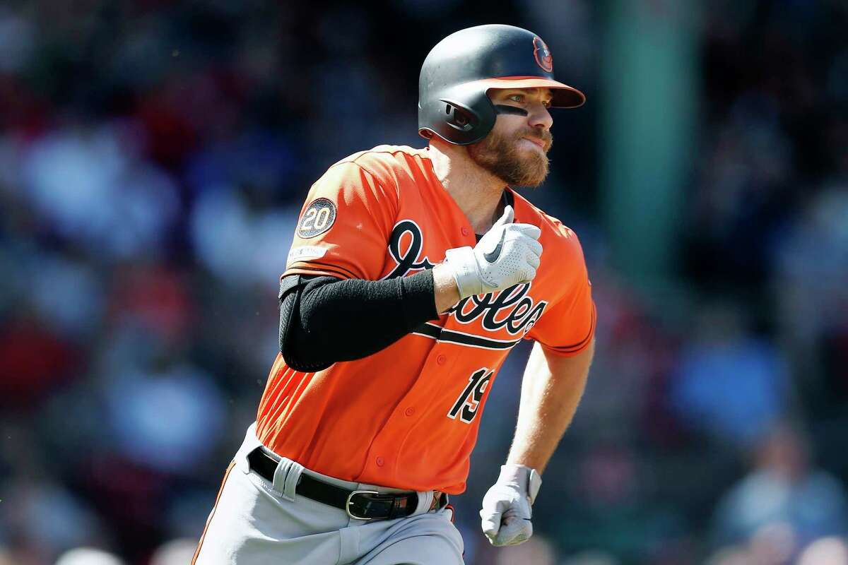 Baltimore Orioles' Chris Davis (19) runs on his RBI double during the fifth inning of a baseball game against the Boston Red Sox in Boston, Saturday, April 13, 2019. (AP Photo/Michael Dwyer)