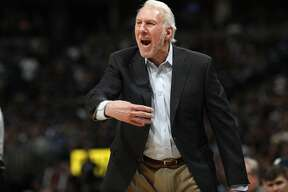 San Antonio Spurs head coach Gregg Popovich directs his team against the Denver Nuggets in the second half of Game 1 of an NBA first-round basketball playoff series, Saturday, April 13, 2019, in Denver. The Spurs won 101-96. (AP Photo/David Zalubowski)