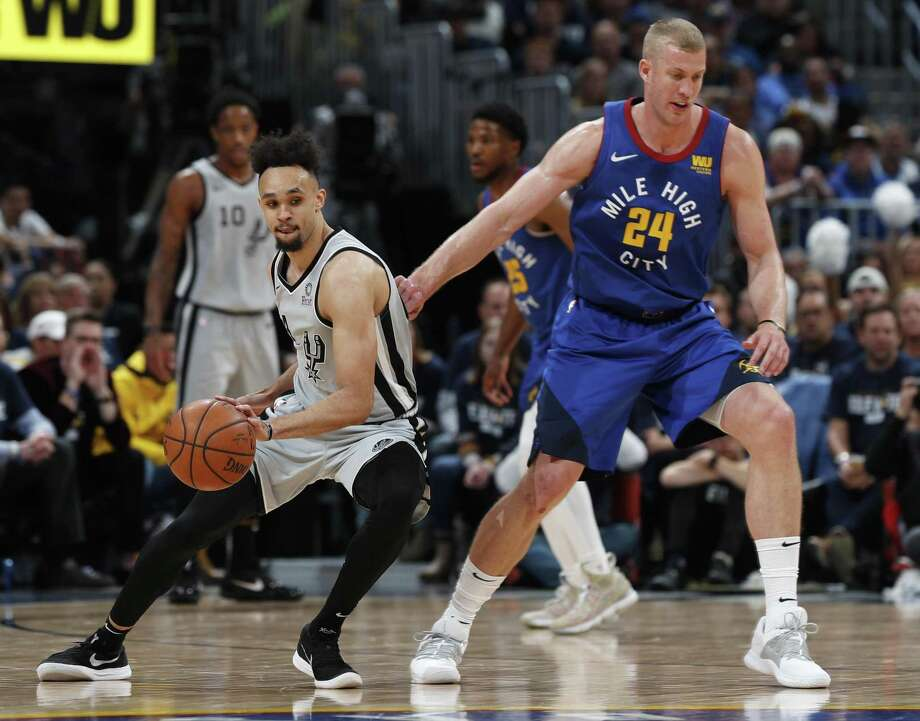 San Antonio Spurs guard Derrick White, left, pulls in a loose ball as Denver Nuggets forward Mason Plumlee defends in the second half of Game 1 of an NBA first-round basketball playoff series, Saturday, April 13, 2019, in Denver. The Spurs won 101-96. (AP Photo/David Zalubowski) Photo: David Zalubowski, STF / Associated Press / Copyright 2019 The Associated Press. All rights reserved.