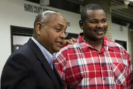 Alfred Dewayne Brown, right, 33, listens to State Senator Rodney Ellis, left, talk about the request to compensate Brown with state funds for his wrongful conviction. Brown's attorneys are seeking almost a million dollars, as well as healthcare and tuition dollars for his daughter's education. Brown was convicted of capital murder and sentenced to death in October 2005. After 12 years imprisoned, his conviction was overturned after the discovery of evidence substantiating his alibi. Monday, Feb. 22, 2016, in Houston.