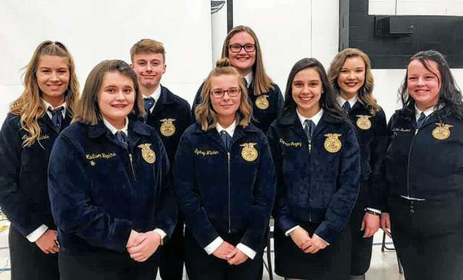 Bluffs' FFA chapter gathered April 3 for its annual end-of-the-year banquet. During the banquet, they presented awards to greenhands, chapter members who were eligible to receive their chapter degrees, and foundation sponsors. They also recognized retiring officers. Those attending the banquet included Madison Hopkins (front row, from left), Sydney Whicker, Kayde Gregory and Ericka Huseman, Alyssa Bartels (back row, from left), Ethan Buhlig, Morgan Hoots and Miriam Hoffman. Photo: Photo Provided