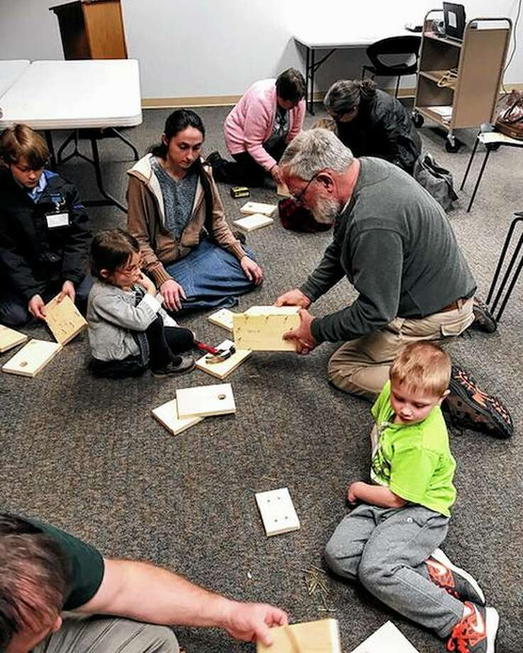 Illinois Audubon Society Young Explorers Club members work on constructing birdhouses during a recent meeting at Jacksonville Public Library. Photo: Photo Provided