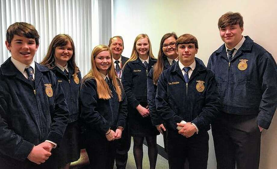 Jacksonville FFA members participated March 19 in Ag Legislative Day at the Capitol in Springfield. Memberes delivered lunches and baskets of agricultural products to representatives. They also explained what FFA is and what opportunities they gain by being part of FFA. Among those participanting were Ryan Hutchison (from left), Anne Becker, Skylar Bartz, Rep. Tom Weber, Katie White, Allison Wheeler, Tyler Christian and Myles Homann. Photo: Photo Provided