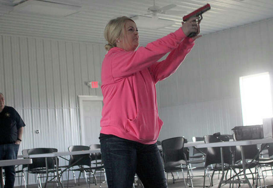 Ann Hungerford, a Citizen's Police Academy participant, went reacted one of the simulated scenarios Saturday. Photo: Rosalind Essig | Journal-Courier