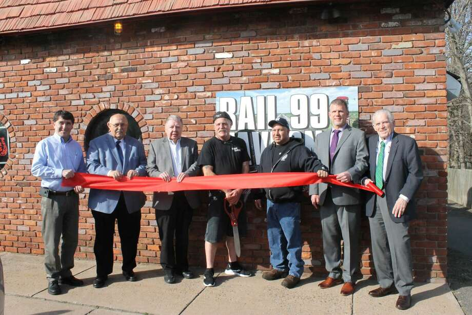 Rail 99 Tavern, a neighborhood tavern at 1 Wall St., Cromwell, held a ribbon cutting April 4. From left are Cromwell Director of Planning & Development Stuart B. Popper, Town Manager Tony Salvatore, Chamber Chairman Jay Polke, owners Frank Mangene and Joseph Latina, Chamber Cromwell Division Chair Rodney Bitgood and President Larry McHugh. Photo: Contributed Photo