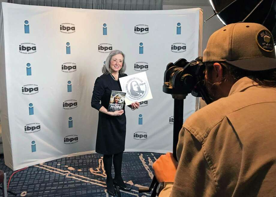 """The Independent Book Publishers Association presented its Benjamin Franklin Award to Connie Bombaci, Killingworth author of """"Hogan's Hope: A Deaf Dog, A Courageous Journey,"""" and """"A Christian's Faith."""" Bombaci was recognized with a silver award in the category of inspiration. Photo: Contributed Photo"""