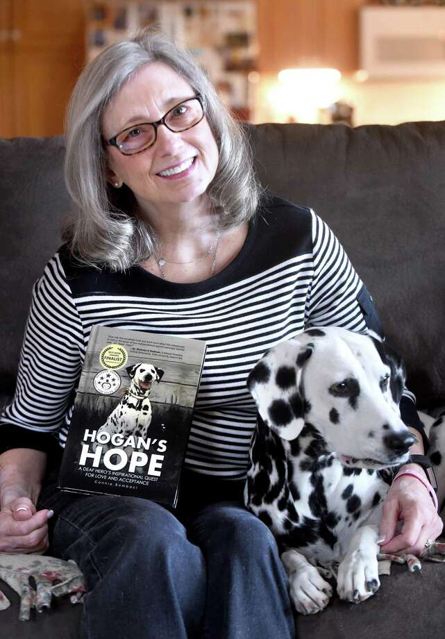 "Connie Bombaci is photographed with her deaf Dalmatian, Judea, at her home in Killingworth last April. Her book, ""Hogan's Hope,"" is a story about her first deaf Dalmatian. Photo: Hearst Connecticut Media File Photo / New Haven Register"