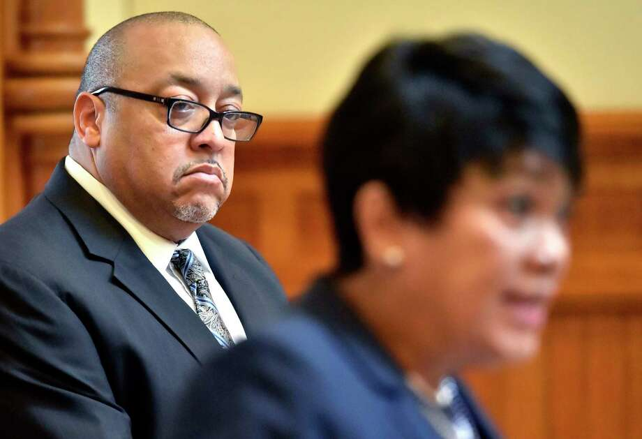 """New Haven, Connecticut - Monday, July 2, 2018: Darnell Goldson, president of the New Haven Board of Education, left, listens to New Haven Mayor Toni Harp during a press conference announcing that the Board of Education would like provide """"guidance and support"""" to the new School superintendent Carol Birk to consider """"performing a more thorough analysis"""" off lay-off notices to 764 public school employees called for by the School Superintendent. Photo: Peter Hvizdak / Hearst Connecticut Media / New Haven Register"""