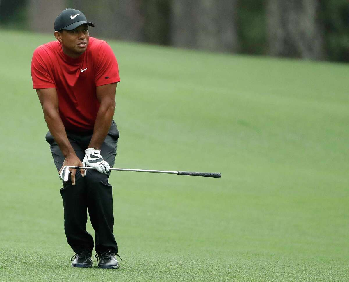 Tiger Woods reacts to his shot on the second hole during the final round for the Masters golf tournament Sunday, April 14, 2019, in Augusta, Ga.