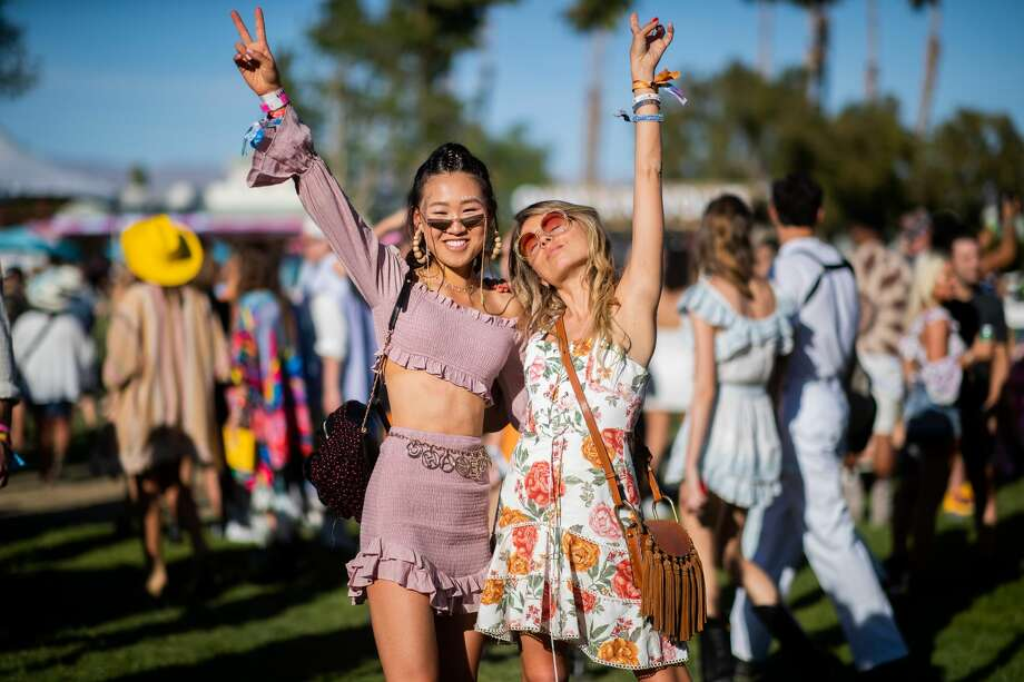 LA QUINTA, CALIFORNIA - APRIL 13: Jaime Xie is seen wearing pink cropped top and skirt and Erica Pelosini wearing dress with floral print, bag with fringes at the Revolve Festival during Coachella Festival on April 13, 2019 in La Quinta, California. (Photo by Christian Vierig/GC Images) Photo: Christian Vierig/GC Images