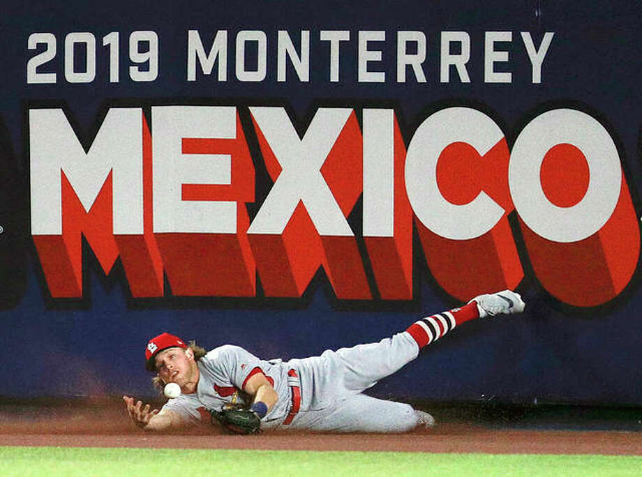 The Cardinals' Harrison Bader can't make the catch on a triple by Cincinnati's Phillip Ervin in the eighth inning of Saturday night's game in Monterrey, Mexico. The Reds defeated the Cardinals 5-2. Photo: AP Photo