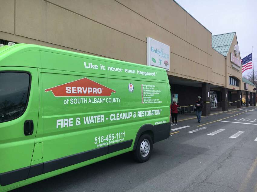 A Servepro fire and water damage cleanup and restoration truck is parked outside the Hannaford on Central Avenue in Albany on Sunday, April 14, 2018. The store closed due to a reported fire and is hoping to open by Monday morning.