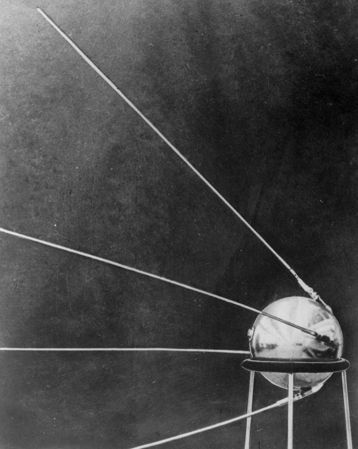 This first official picture of the Soviet satellite Sputnik I was issued in Moscow October 9, 1957, showing the satellite with its four antennas resting on a pedestal. Working in obsessive secrecy, the Soviets propelled the Sputnik satellite into space on Oct. 4, 1957, making it the first man-made object to reach the limits of the earth's gravity. It also triggered the Space Age and changes to everyday life that people now take for granted.