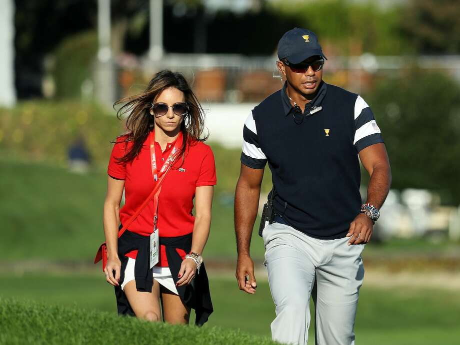 Tiger Woods and his partner Erica Herman. Photo: Rob Carr/Getty
