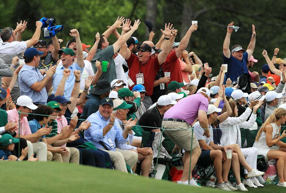 AUGUSTA, GEORGIA - APRIL 14: Patrons cheers after Tiger Woods of the United States sunk a putt for birdie on the 16th green during the final round of the Masters at Augusta National Golf Club on April 14, 2019 in Augusta, Georgia. (Photo by Mike Ehrmann/Getty Images)
