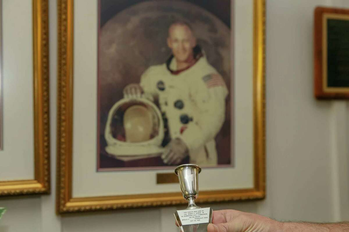 Jim Spivey, treasurer of the Webster Presbyterian Church near NASA, holds the original chalice that then-church member and astronaut Buzz Aldrin took with him on the Apollo 11 space mission to the moon. It is shown here on April 7, 2019.
