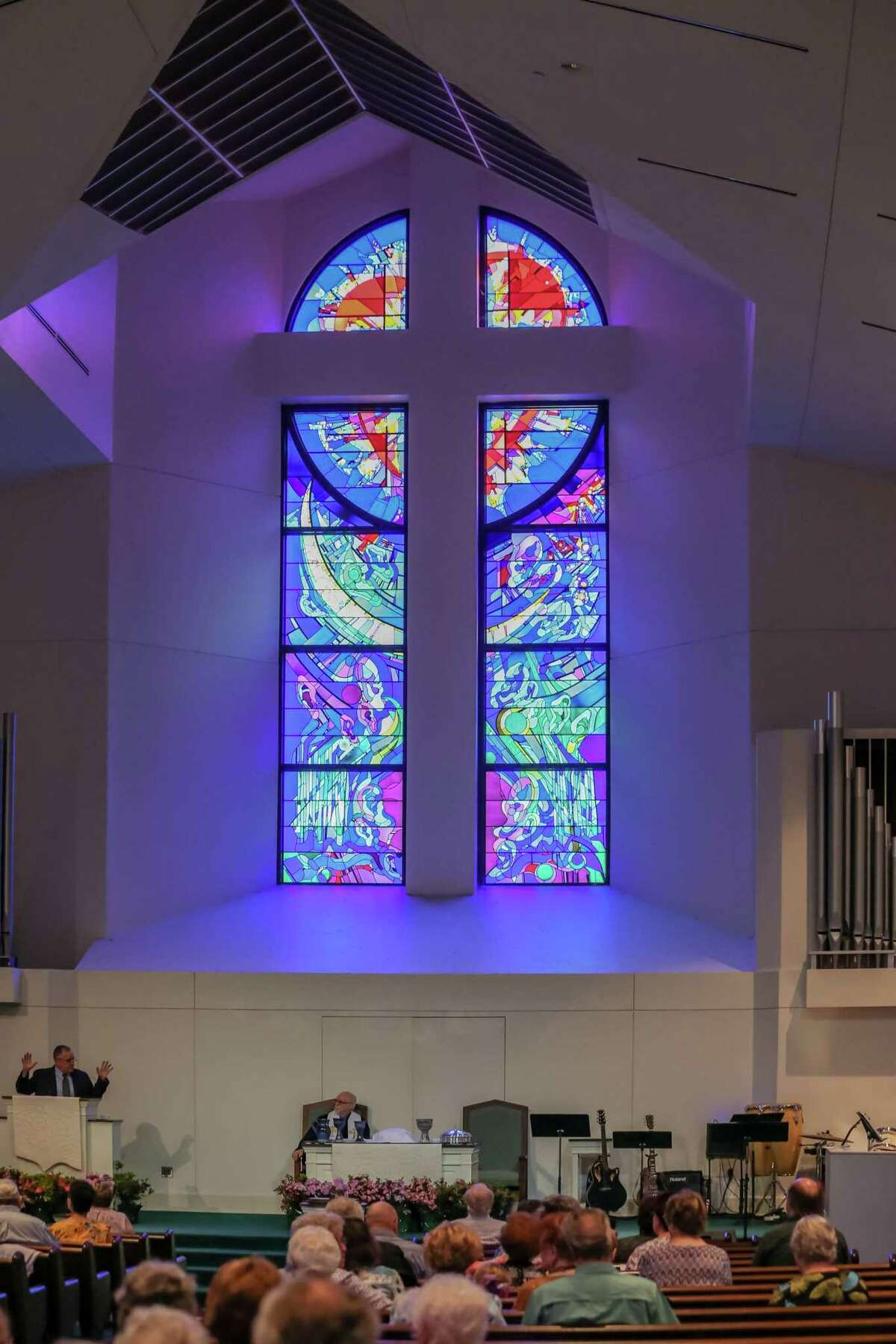 The main stained glass window in the sanctuary of the Webster Presbyterian Church near NASA, depicts U.S. space missions to the moon. It is shown here on April 7, 2019.
