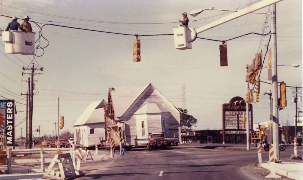 This is the old Webster Presbyterian Church being moved down NASA Road 1 in the 1980s to become what is today the Bay Area Museum in Clear Lake Park.