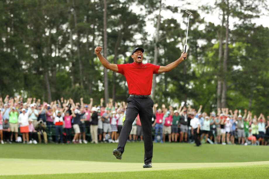 Tiger Woods of the United States celebrates after sinking his putt on the 18th green to win during the final round of the Masters at Augusta National Golf Club on April 14, 2019 in Augusta, Georgia. Photo: Kevin C. Cox, Staff / Getty Images / 2019 Getty Images
