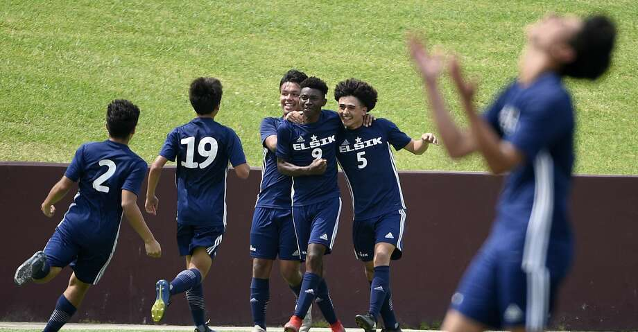Elsik midfielder Dandord Ndabah (9) celebrates his goal with Andrei Aguirre (5) and teammates during the second half of a 6A region 3 final high school soccer match against Spring Woods, Saturday, April 13, 2019, in Deer Park. Photo: Eric Christian Smith/Contributor