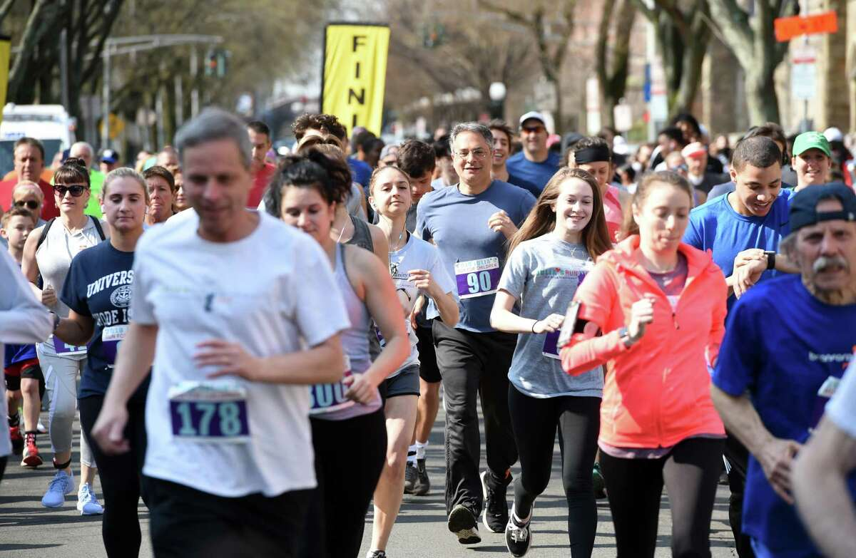 Runners begin the 20th annual Julia's Run for Children at Yale University's Cross Campus in New Haven on April 14, 2019 with proceeds benefiting LEAP. The race celebrates the memory of Julia Rusinek, who died in 1999 as a senior at Yale University, and her commitment to running and children. The run included a 4-mile event and a .7-mile Fun Run for children.