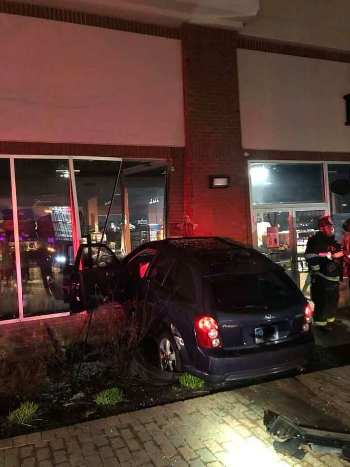 A car crashed into the Pet Valu store at 37 Monroe Turnpike early morning on April 14, 2019. Photo: Long Hill Volunteer Fire Company Facebook Page / Contributed Photo