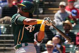 Oakland Athletics' Khris Davis (2) hits an RBI double in the first inning against the Texas Rangers on Sunday, April 14, 2019 in Arlington, Texas. (Richard W. Rodriguez/Fort Worth Star-Telegram/TNS)