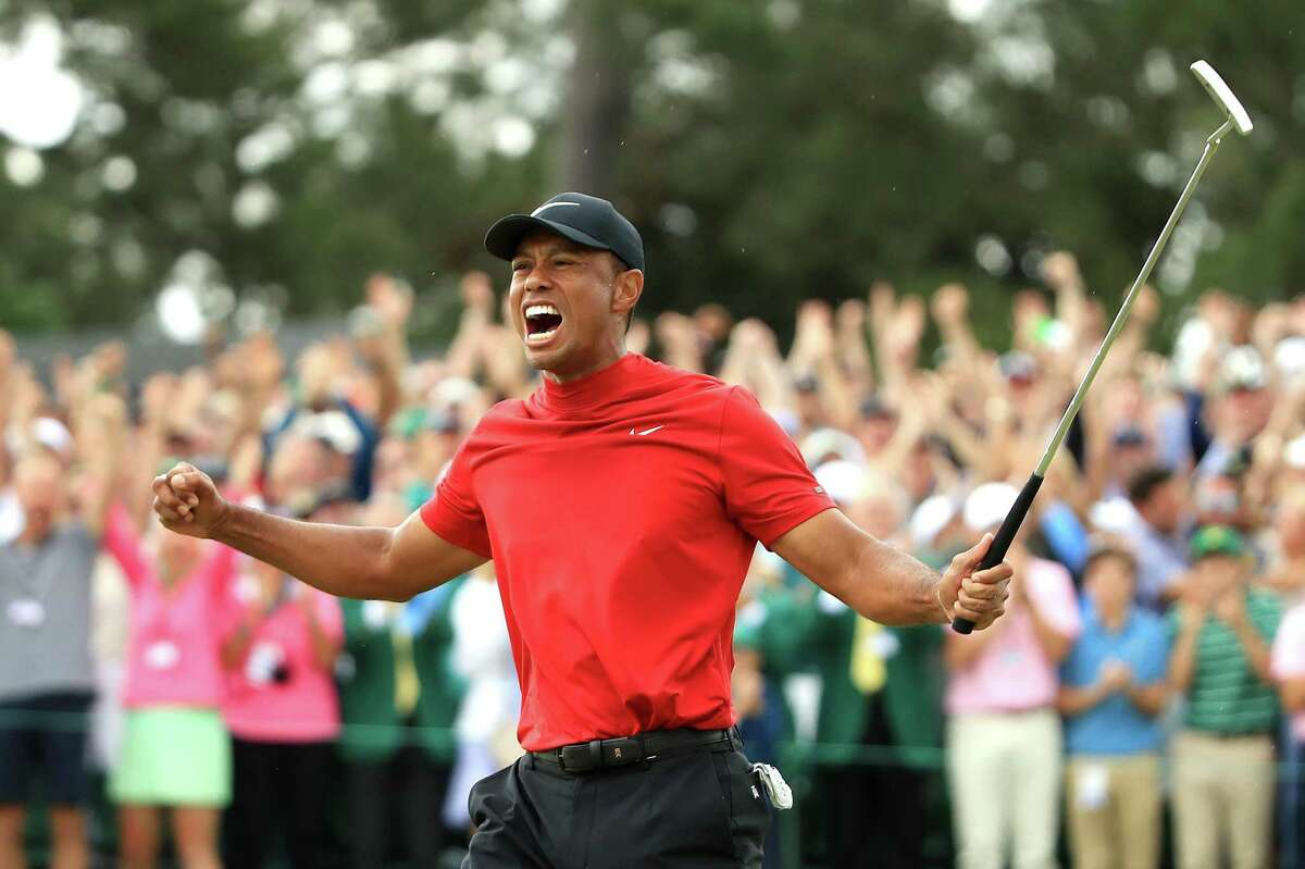 AUGUSTA, GEORGIA - APRIL 14: Tiger Woods of the United States celebrates after sinking his putt to win during the final round of the Masters at Augusta National Golf Club on April 14, 2019 in Augusta, Georgia. (Photo by Andrew Redington/Getty Images) *** BESTPIX ***