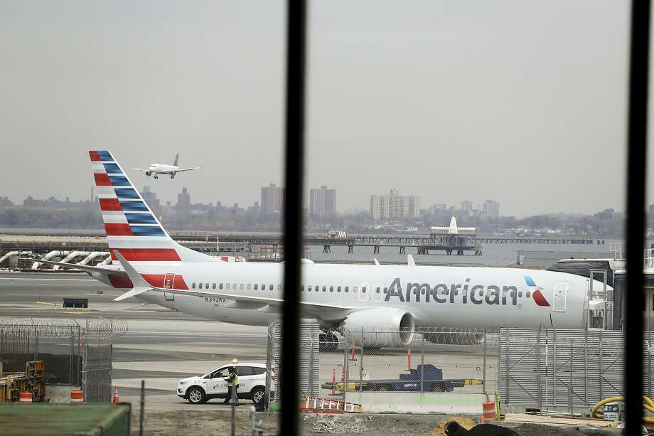 FILE - In a March 13, 2019 file photo, an American Airlines Boeing 737 MAX 8 sits at a boarding gate at LaGuardia Airport in New York. American Airlines is canceling 115 flights per day through mid-August because of ongoing problems with the Boeing 737 Max aircraft. (AP Photo/Frank Franklin II, File) Photo: Frank Franklin II, Associated Press