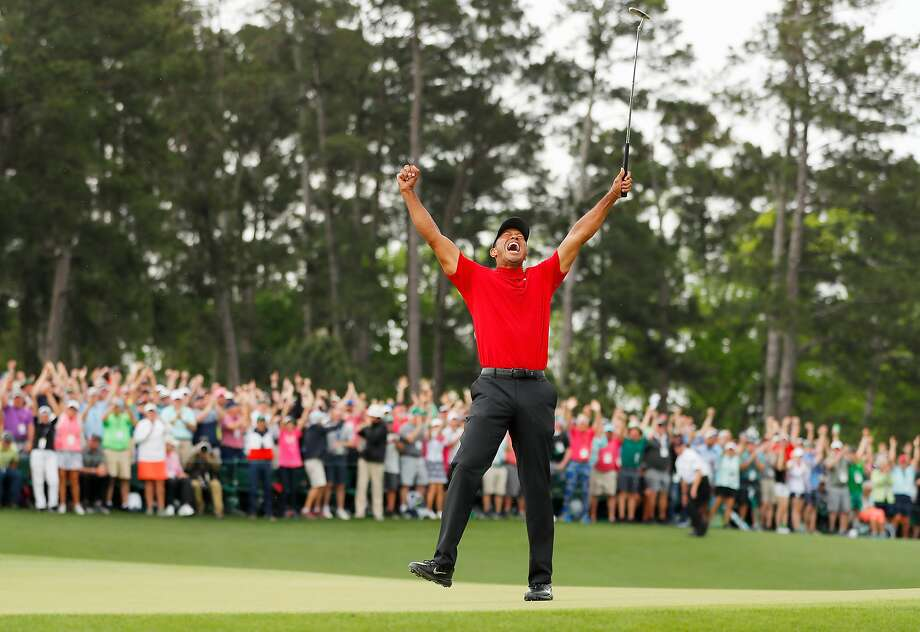 AUGUSTA, GEORGIA - APRIL 14: (Sequence frame 6 of 12) Tiger Woods of the United States celebrates after making his putt on the 18th green to win the Masters at Augusta National Golf Club on April 14, 2019 in Augusta, Georgia. (Photo by Kevin C. Cox/Getty Images) Photo: Kevin C. Cox / Getty Images