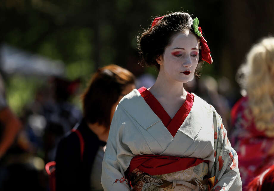 """Courtney Rose stands quietly during a break at Japan Festival Houston at Hermann Park on Sunday, April 14, 2019, in Houston. """"I'm actually a history major who is going into museums and museum curation,"""" she said. Photo: Jon Shapley, Staff Photographer / © 2019 Houston Chronicle"""