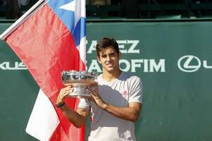 Christian Garin holds the championship trophy after defeating Casper Ruud at the singles finals of the US Men's Clay Court Championships at River Oaks Country Club in Houston, TX on Sunday, April 14, 2019.
