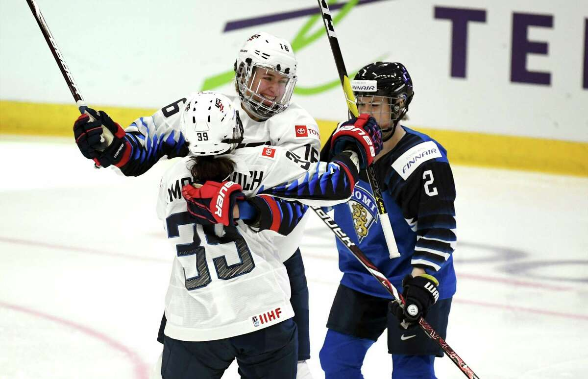 Melissa Samoskevich, left, and Hayley Scamurra of USA celebrate the equalizing 2-2 goal during the 2019 IIHF Women's World Championships preliminary match between Finland and USA in Espoo, Finland, Thursday April 4, 2019. At right Isa Rahunen of Finland.