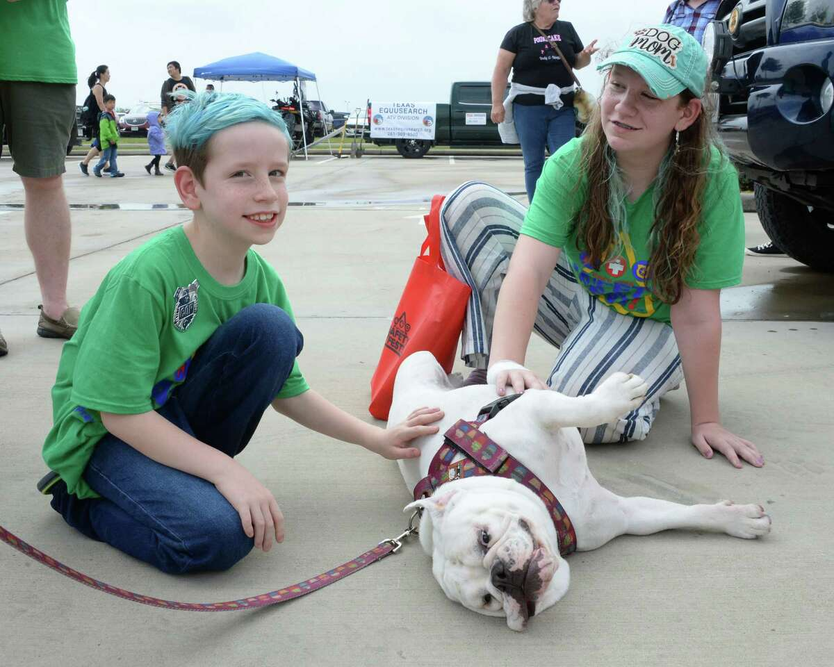 Poundcake, a rescue dog with the Frank's Way Foundation gets attention from Makayla Graf, right, and brother Jackson during the Katy Area Safety Fest in Katy, TX on Saturday, April 13, 2019.