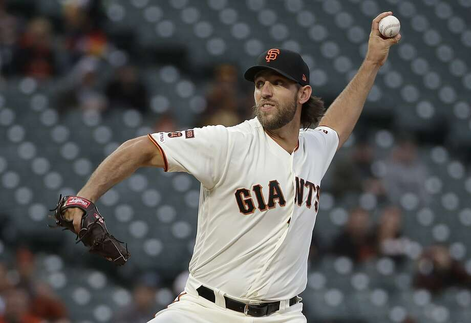 Madison Bumgarner pitched before a lot of empty seats at the start of an April 8 night game against the San Diego Padres. Photo: Jeff Chiu / Associated Press