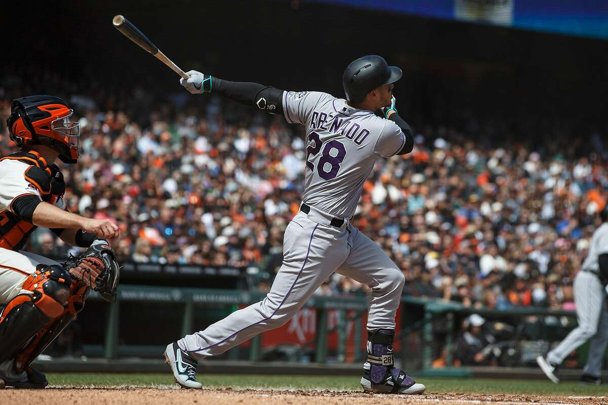 SAN FRANCISCO, CA - APRIL 14: Nolan Arenado #28 of the Colorado Rockies hits a three run home run against the San Francisco Giants during the fifth inning at Oracle Park on April 14, 2019 in San Francisco, California. The Colorado Rockies defeated the San Francisco Giants 4-0. (Photo by Jason O. Watson/Getty Images)
