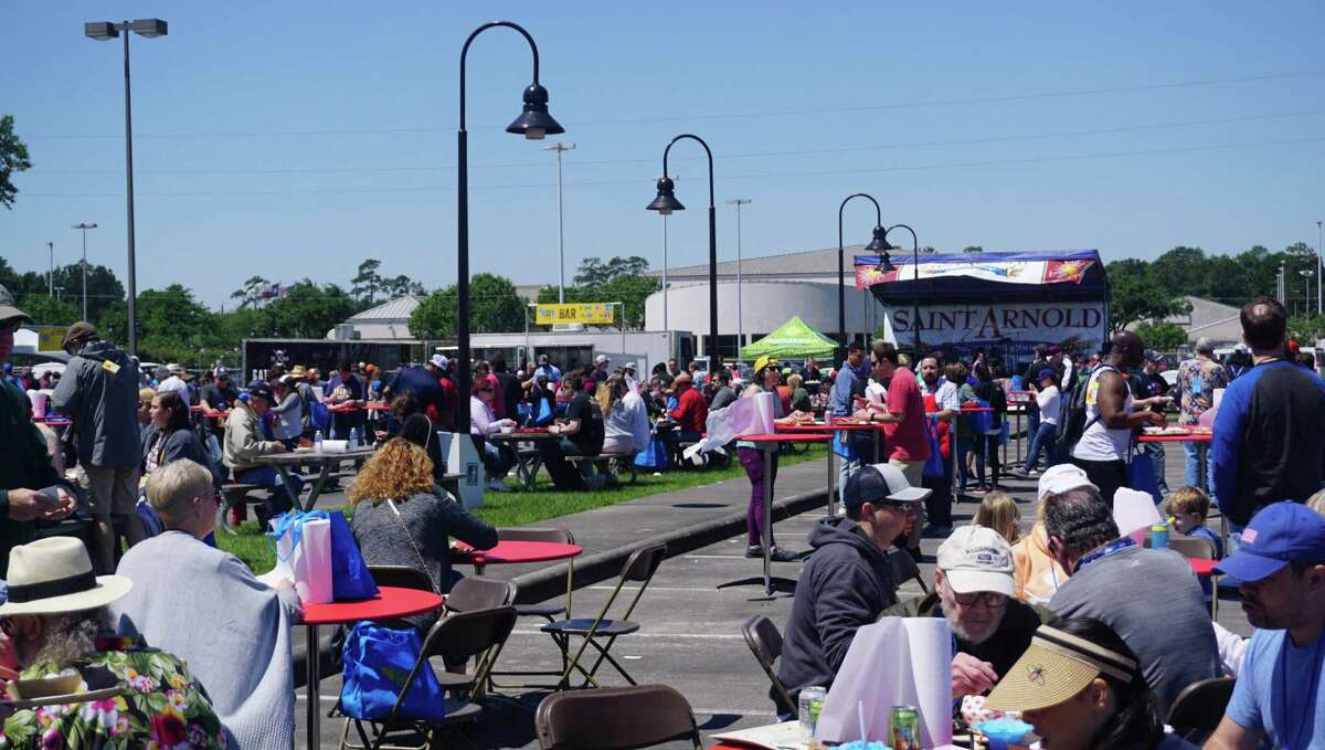 The crowd pours into the outdoor area of the Humble Civic Center Arena for the 7th Annual Houston Barbecue Festival on April 14 in Humble.