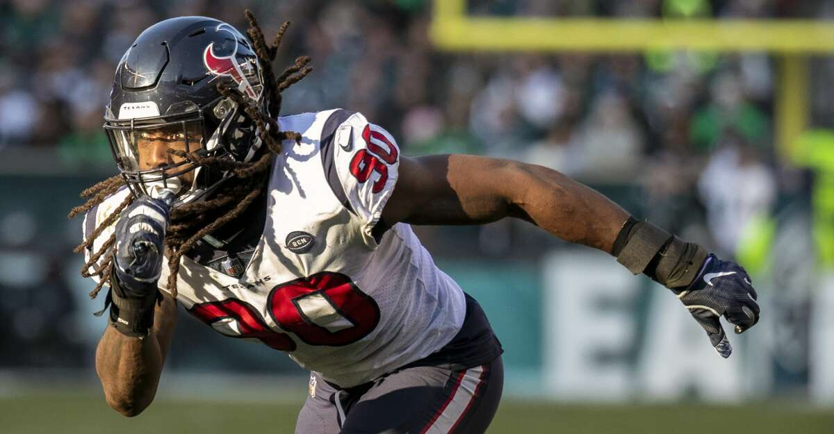 FILE - In this Dec. 23, 2018, file photo, Houston Texans outside linebacker Jadeveon Clowney moves toward the action during an NFL football game against the Philadelphia Eagles, in Philadelphia. The Houston Texans have placed the non-exclusive franchise tag on defensive end/outside linebacker Jadeveon Clowney. (AP Photo/Chris Szagola, File)