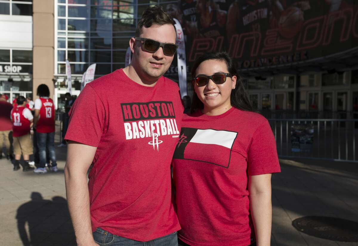 Houston Rockets fans pose for a pohotograph outside the Toyota Center before the Game 1 of a NBA basketball first round series against the Utah Jazz on Sunday, April 14, 2019, in downtown Houston.