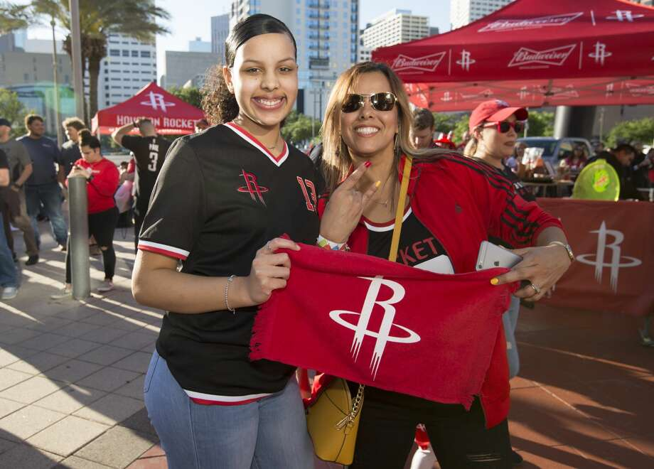 Houston Rockets fans pose for a pohotograph outside the Toyota Center before the Game 1 of a NBA basketball first round series against the Utah Jazz on Sunday, April 14, 2019, in downtown Houston. Photo: Yi-Chin Lee/Staff Photographer