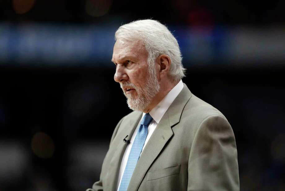 San Antonio Spurs coach Gregg Popovich watches play in the closing minutes of the team's NBA basketball game against the Dallas Mavericks in Dallas, Tuesday, March 12, 2019. (AP Photo/Tony Gutierrez) Photo: Tony Gutierrez, STF / Associated Press / Copyright 2019 The Associated Press. All rights reserved.