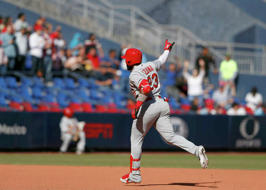 The Cardinals' Marcell Ozuna gestures to fans as he runs the bases following hitting his second home run of the game in the seventh inning of Sunday's game against the Reds in Monterrey, Mexico. Photo: AP Photo
