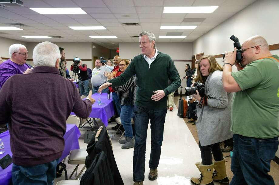 FILE -- New York Mayor Bill de Blasio arrives to speak in Des Moines, Iowa, on Feb. 24, 2019. De Blasio is doing all the things politicians do before announcing a presidential run, including courting big and small donors. (Scott Morgan/The New York Times) Photo: SCOTT MORGAN / NYTNS