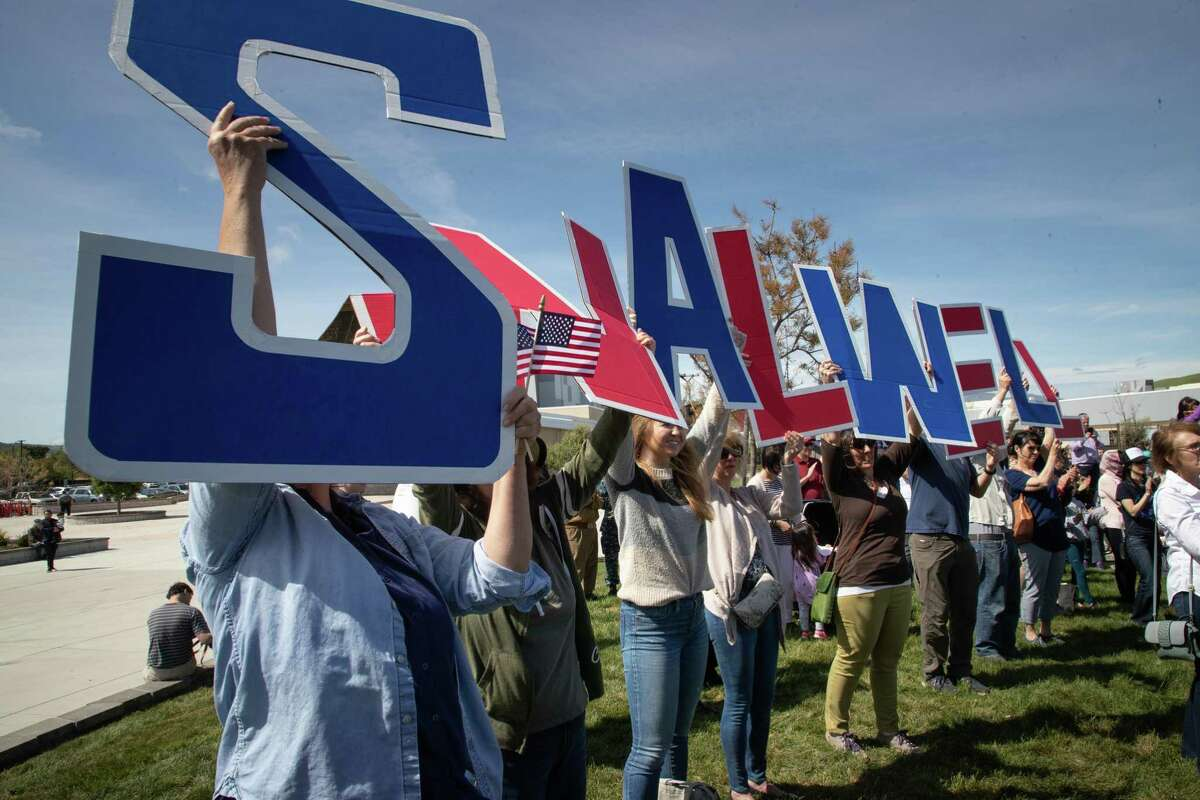 Supporters spell out Swalwell's name during his speech at Dublin High School in his home district.