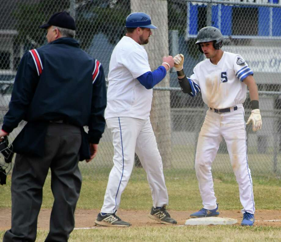 Saratoga Springs' Christian Kondo gets a fist bump from head coach Andy Cuthbertson after hitting a triple during a baseball game against Shenendehowa on Thursday, April 11, 2019 in Saratoga Springs, N.Y. (Lori Van Buren/Times Union) Photo: Lori Van Buren / 20046653A