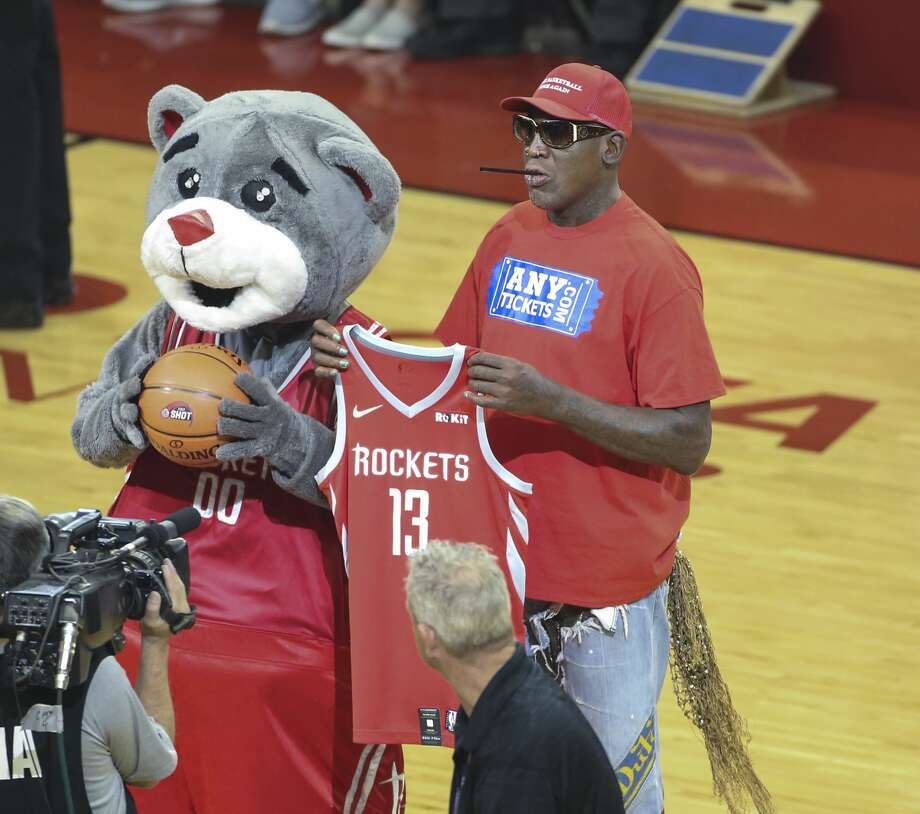 """PHOTOS: How celebrities have done on the """"First Shot"""" before Rockets games this season Dennis Rodman through out the first shot for a fundraiser, missing a free throw before the Houston Rockets take on the Utah Jazz or the first game of an NBA playoff series at Toyota Center on Sunday, April 14, 2019 in Houston. Browse through the photos above to see which celebrities have made the """"First Shot"""" before Rockets games this season ... Photo: Elizabeth Conley/Staff Photographer"""