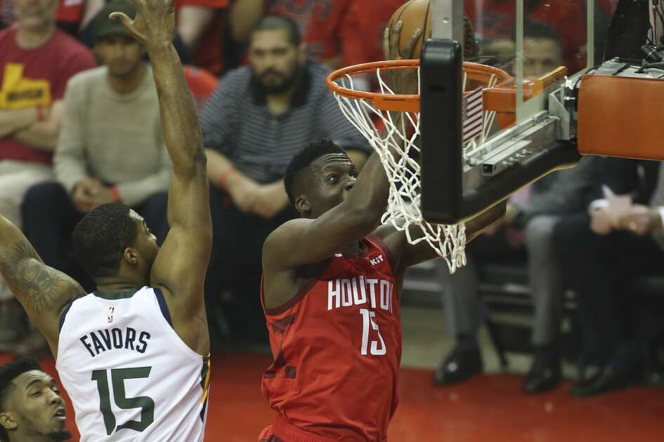 Houston Rockets center Clint Capela (15) puts up a shot around Utah Jazz forward Derrick Favors (15) in the first game of an NBA playoff series at Toyota Center on Sunday, April 14, 2019 in Houston.