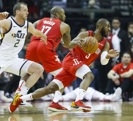 Houston Rockets guard Chris Paul (3) drives past Utah Jazz forward Joe Ingles (2) during the first half of the first round of the NBA playoffs at Toyota Center, Sunday, April 14, 2019, in Houston.